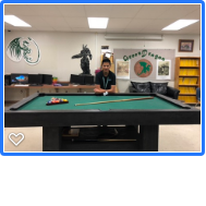 Jacob posing with his pool table.